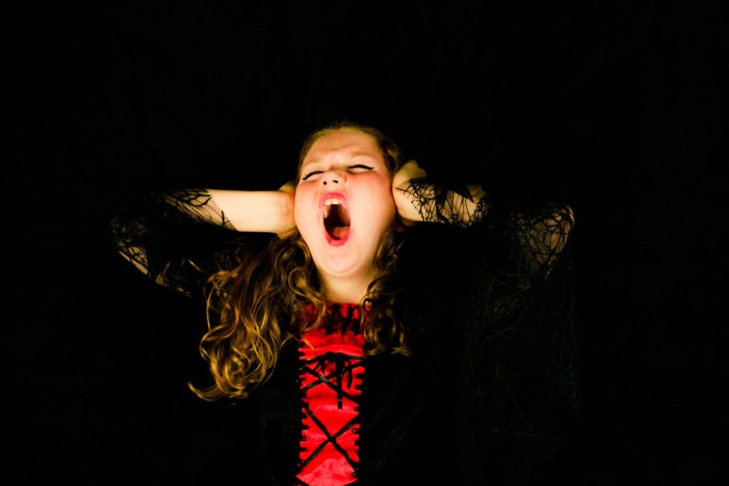 A defiant child screaming due to an anger outburst.