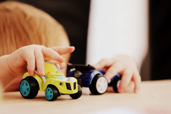 Toddler throws toys instead of playing with them