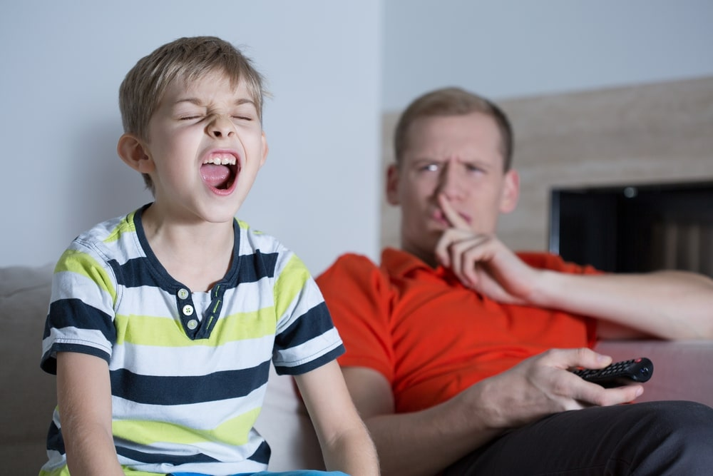 Permissive Parenting leading a child to scream in front of his dad while he's watching TV