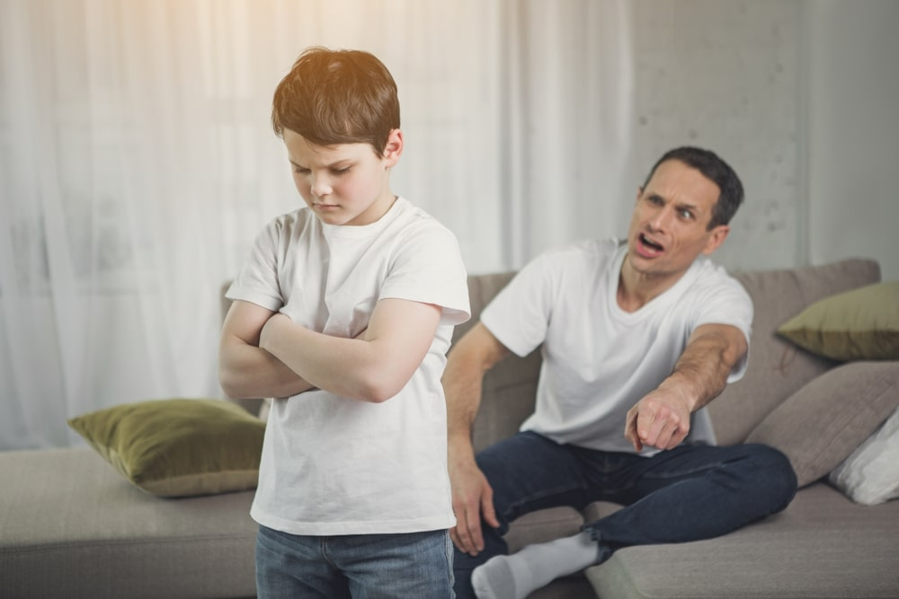 Permissive dad finally punishing his stubborn and misbehaving child