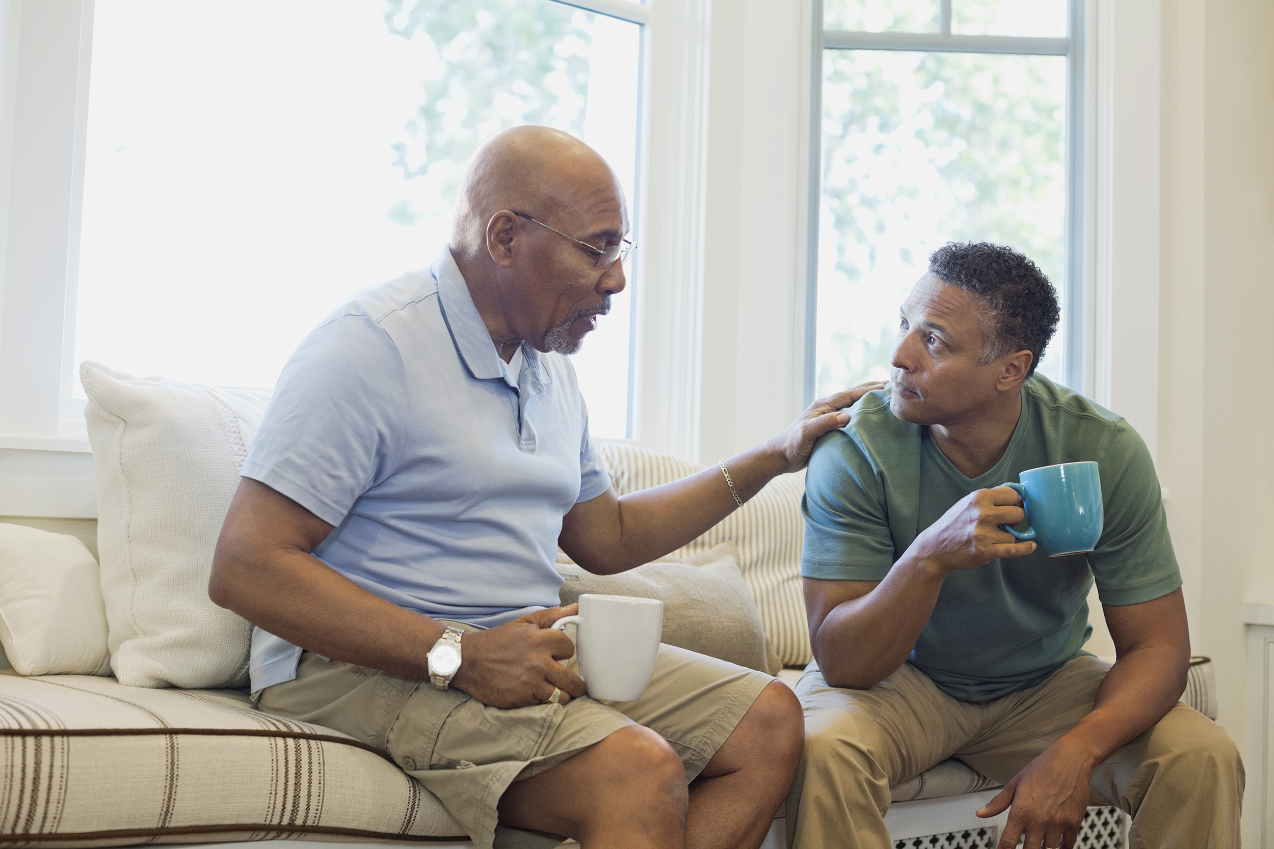 Father having conversation with grown child who makes bad decisions